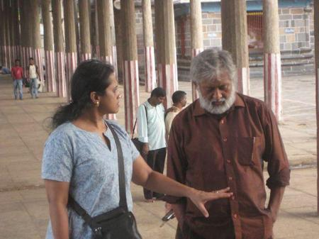 Madhu Ambat inside a temple shooting