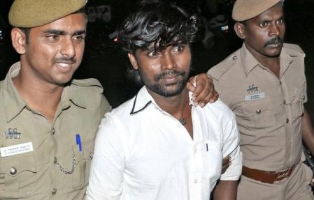 Veeran alias V. Veerasamy, convicted in Pollachi twin rape case, being brought out of the Mahila Court in Coimbatore on Wednesday 24-12-2014.